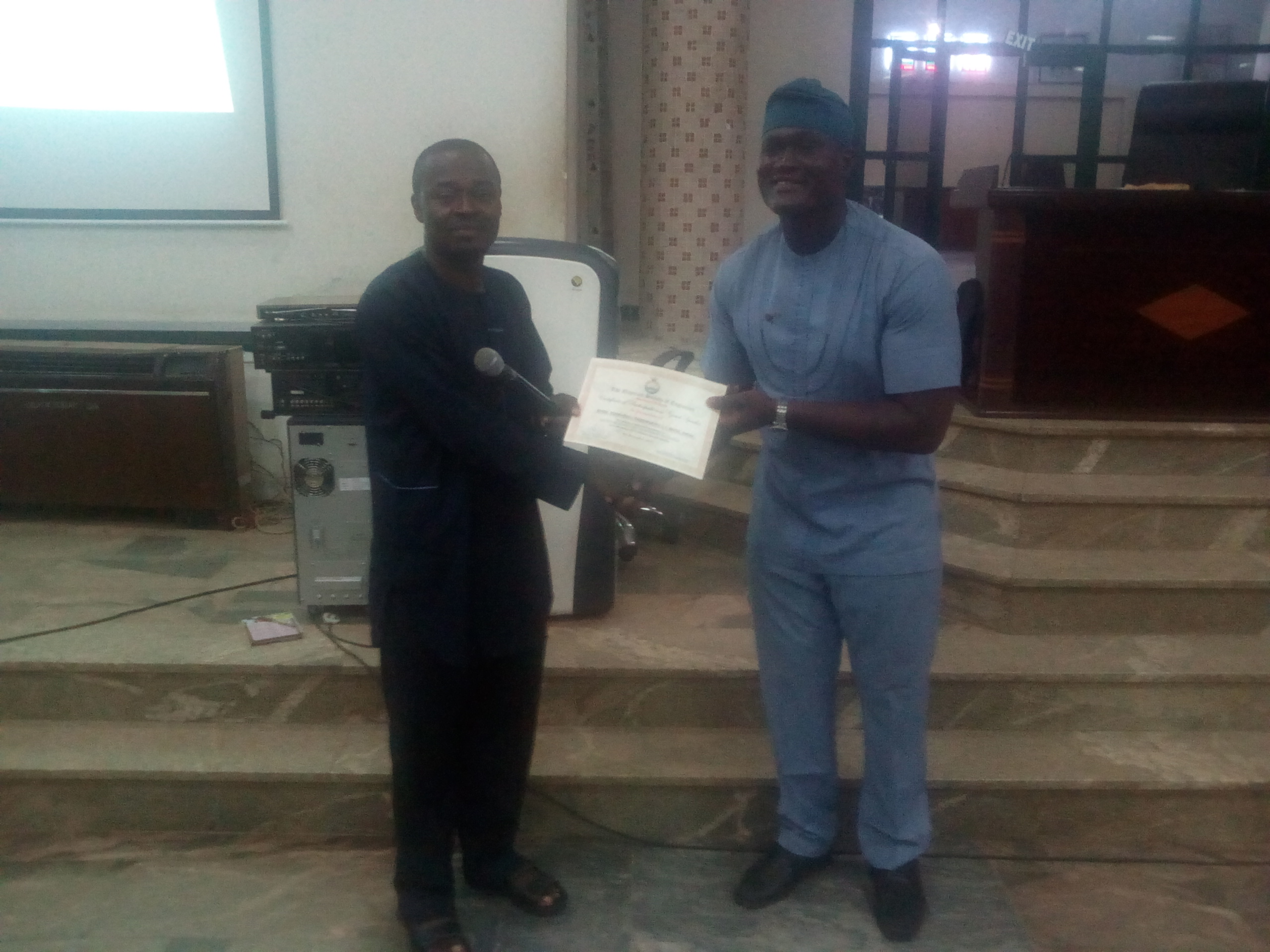 THE CHAIRMAN PRESENTING CERTIFICATE TO THE PRESENTER DURING ONE OF THE BRANCH OGM